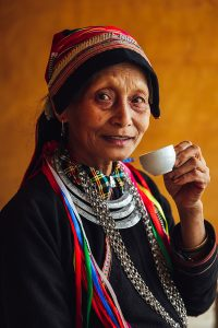 Dao-ethnic-woman-drinking-tea-in-nam-dam-village